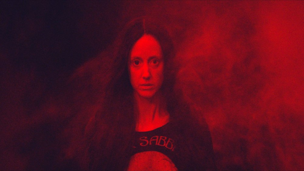 mandy-2018-007-andrea-riseborough-rock-t-shirt-red-background-crop